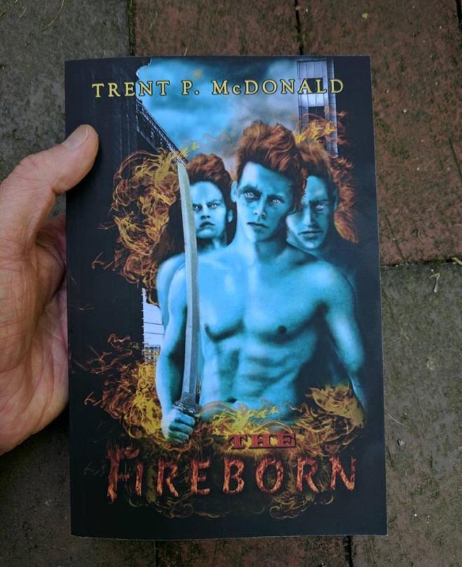 fireborn-book-in-hand (1)